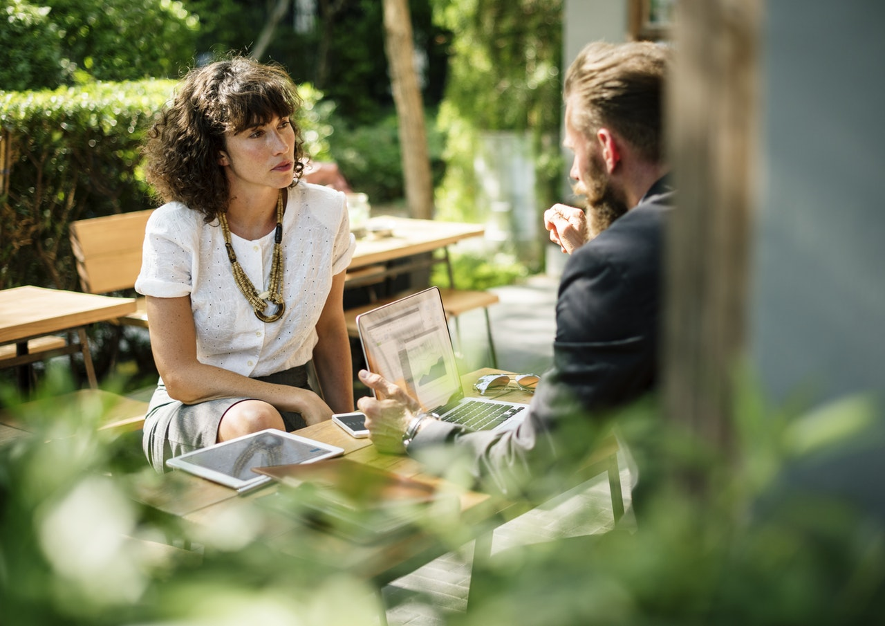 most common interview questions - two persons having an outdoor meeting